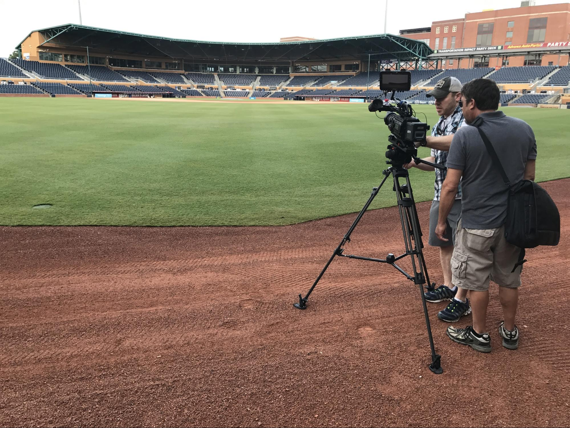 Matt Bowman, our director of video services, sets up the camera for one of Brad's first shots of the day. Why was it first on our list? We had to get this shot before the sun rose above the stadium.